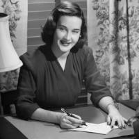 vintage-woman-writing-letter-at-desk
